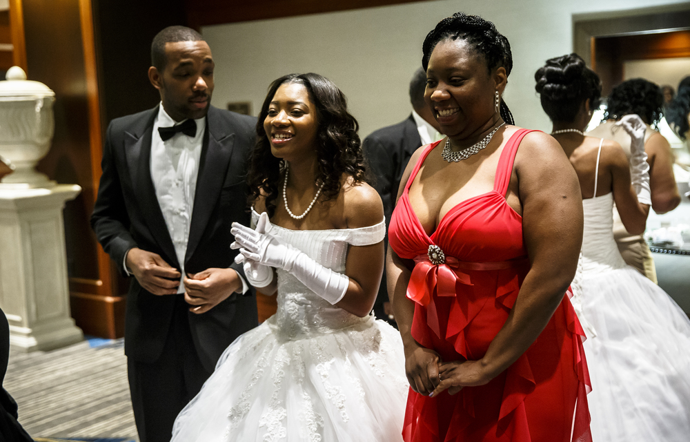 Debutante Laneisha Straughter, center, gets ready to be escorted in by her mother, Lawana Harper, right, during Alpha Kappa Alpha Sorority Nu Omicron Omega Chapter's 18th Annual Debutante Cotillion Fashionetta 2016 at the Crowne Plaza Hotel, Saturday, March 26, 2016, in Springfield, Ill. Justin L. Fowler/The State Journal-Register