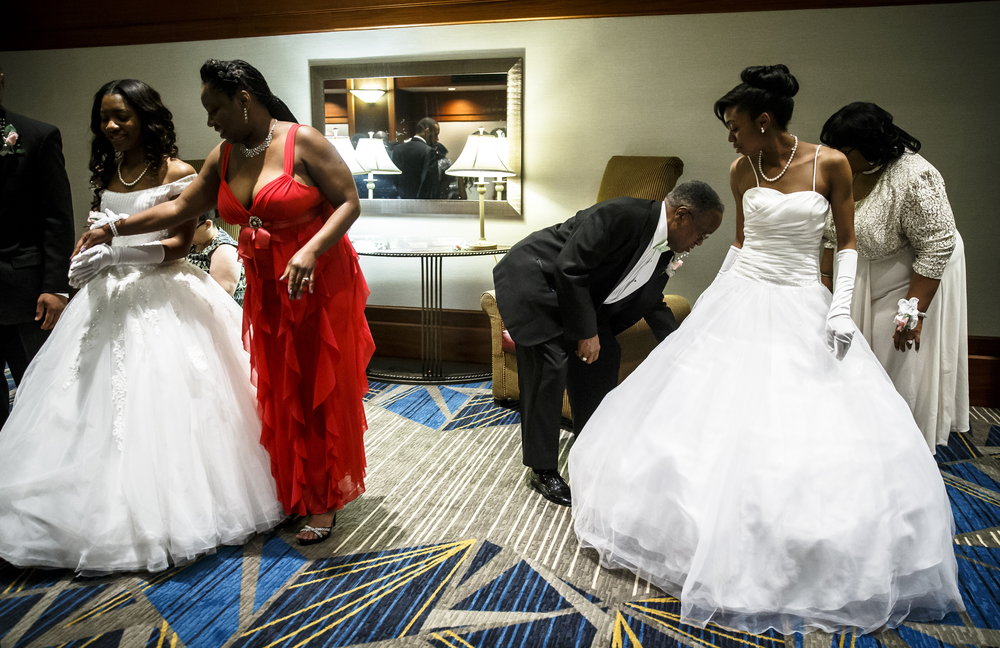 Debutantes Laneisha Straughter, left, and Joy Waddy, right, get a last look over from their parents as they prepare to make their entrance during Alpha Kappa Alpha Sorority Nu Omicron Omega Chapter's 18th Annual Debutante Cotillion Fashionetta 2016 at the Crowne Plaza Hotel, Saturday, March 26, 2016, in Springfield, Ill. Justin L. Fowler/The State Journal-Register