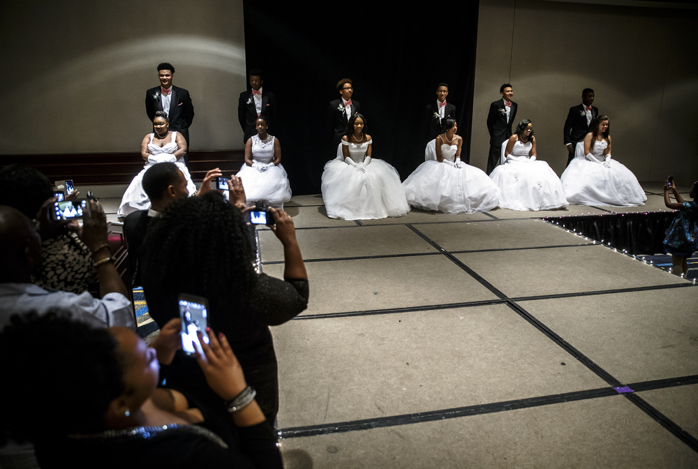 Friends and family take their moment to snap a picture of the debutantes and their escorts during Alpha Kappa Alpha Sorority Nu Omicron Omega Chapter's 18th Annual Debutante Cotillion Fashionetta 2016 at the Crowne Plaza Hotel, Saturday, March 26, 2016, in Springfield, Ill. Justin L. Fowler/The State Journal-Register