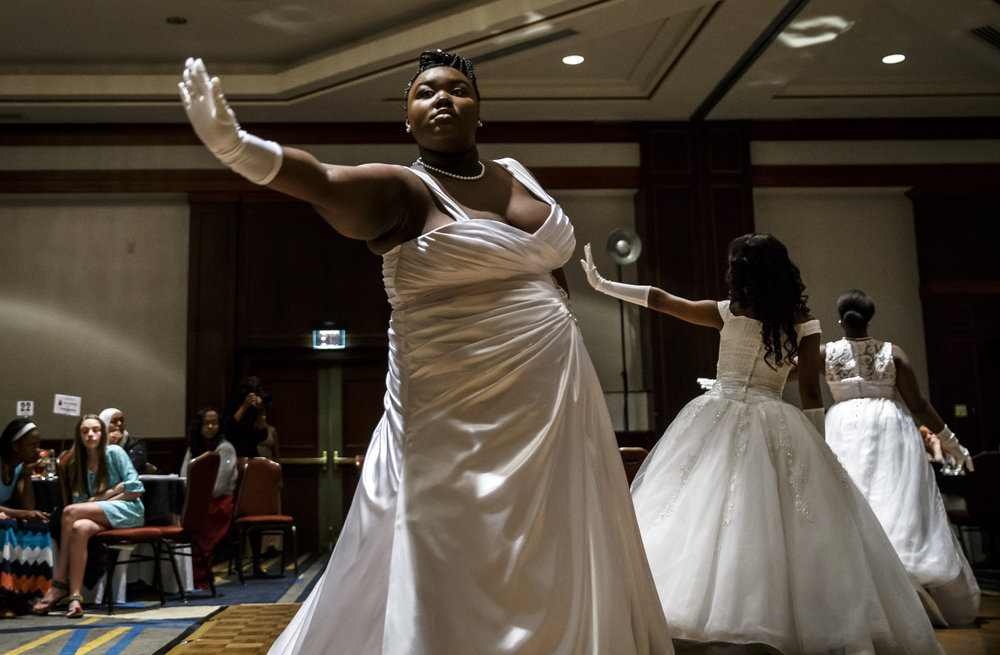 Debutante Jazmen Britts performs a piece of choreography with her fellow Debutantes during Alpha Kappa Alpha Sorority Nu Omicron Omega Chapter's 18th Annual Debutante Cotillion Fashionetta 2016 at the Crowne Plaza Hotel, Saturday, March 26, 2016, in Springfield, Ill. Justin L. Fowler/The State Journal-Register