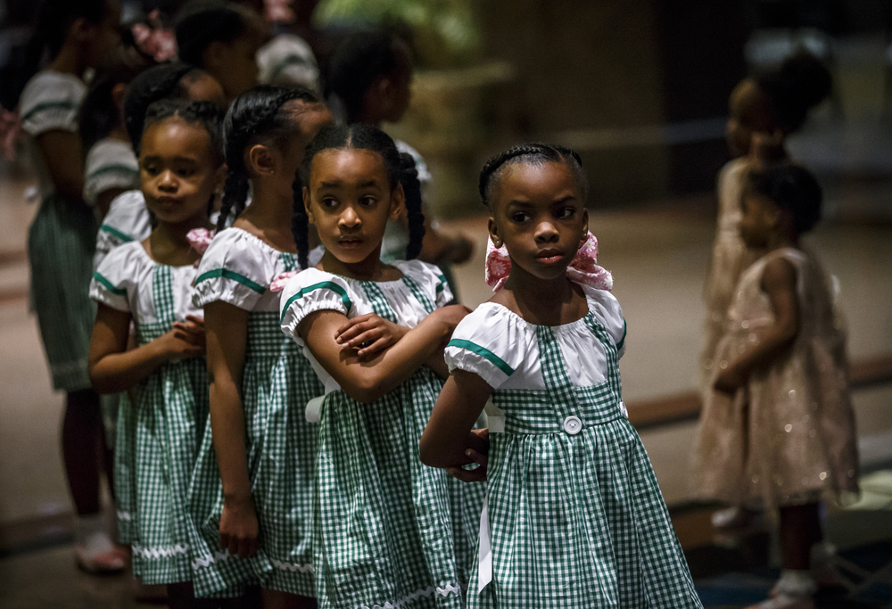 Jalisa Day, 8, and the Fashionetta Pearlettes get ready in line before entering the ballroom to perform their routine during Alpha Kappa Alpha Sorority Nu Omicron Omega Chapter's 18th Annual Debutante Cotillion Fashionetta 2016 at the Crowne Plaza Hotel, Saturday, March 26, 2016, in Springfield, Ill. Justin L. Fowler/The State Journal-Register