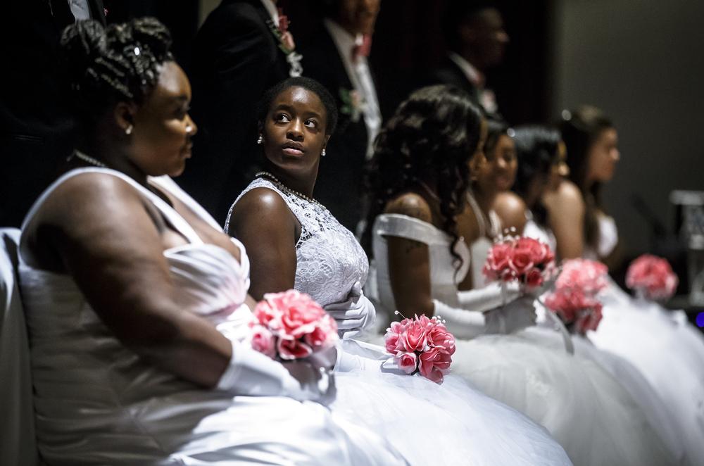 Debutante Munah Henderson on stage with her fellow Debutantes during Alpha Kappa Alpha Sorority Nu Omicron Omega Chapter's 18th Annual Debutante Cotillion Fashionetta 2016 at the Crowne Plaza Hotel, Saturday, March 26, 2016, in Springfield, Ill. Justin L. Fowler/The State Journal-Register
