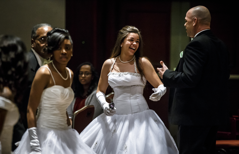 Debutante Jessica Freeman smiles back at her father, David Freeman, after they finished their dance together during Alpha Kappa Alpha Sorority Nu Omicron Omega Chapter's 18th Annual Debutante Cotillion Fashionetta 2016 at the Crowne Plaza Hotel, Saturday, March 26, 2016, in Springfield, Ill. Justin L. Fowler/The State Journal-Register