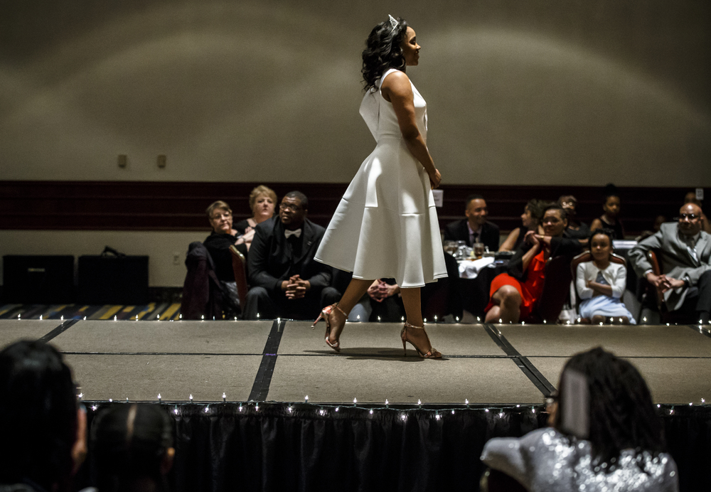 Tatyana Gardner, Miss Fashionetta 2015, takes her last walk with the crown during Alpha Kappa Alpha Sorority Nu Omicron Omega Chapter's 18th Annual Debutante Cotillion Fashionetta 2016 at the Crowne Plaza Hotel, Saturday, March 26, 2016, in Springfield, Ill. Justin L. Fowler/The State Journal-Register