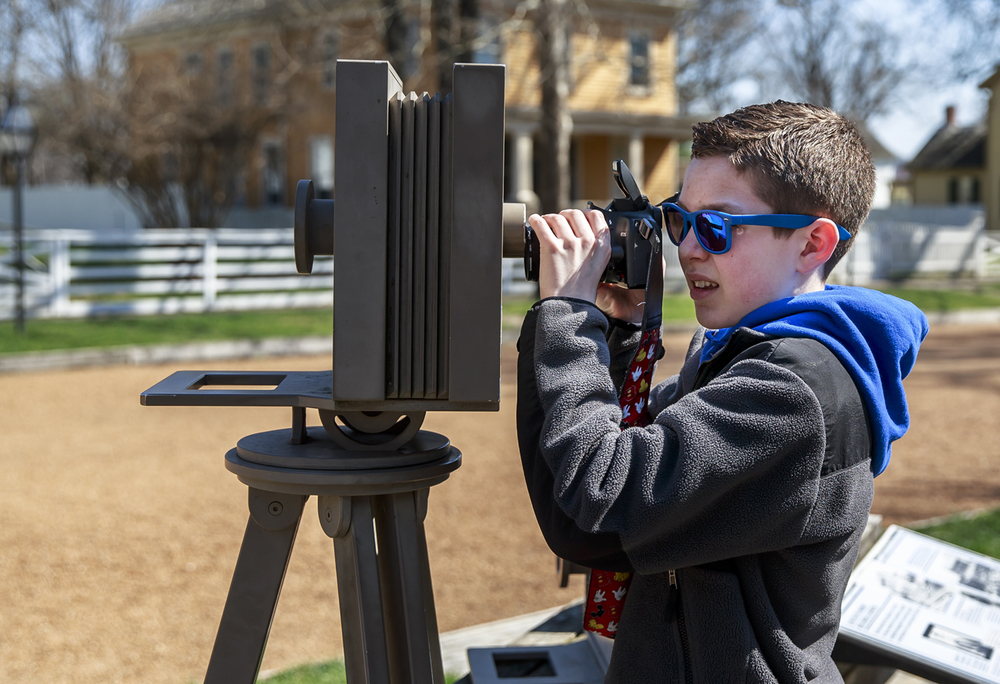 Ryan Boone, 14, of Oswego, Ill., tries to line up his camera through the most famous vantage point used to photograph the Lincoln Home while visiting the Lincoln Home National Historic Site with his family, Monday, March 21, 2016, in Springfield, Ill. Justin L. Fowler/The State Journal-Register