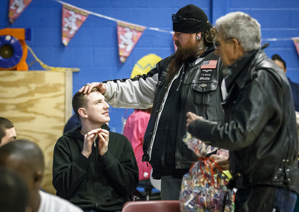 Craig Jones, owner of Jones Chop Shop, visits with Eric, 19, as he visits with a group at the Hope Institute that he cuts their hair for during the 27th annual Easter Basket Run, sponsored by the Lincoln Land Chapter of ABATE of Illinois, Sunday, March 20, 2016, in Springfield, Ill. Justin L. Fowler/The State Journal-Register