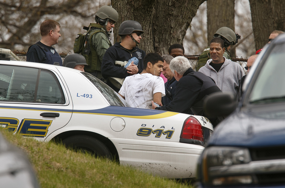 Springfield Police take a suspect into custody at the scene of a stand-off where a man was barricaded with a gun after shots were fired on Lilac Lane in Springfield Wednesday, March 23, 2016. The stand-off ended peacefully. Ted Schurter/The State Journal-Register