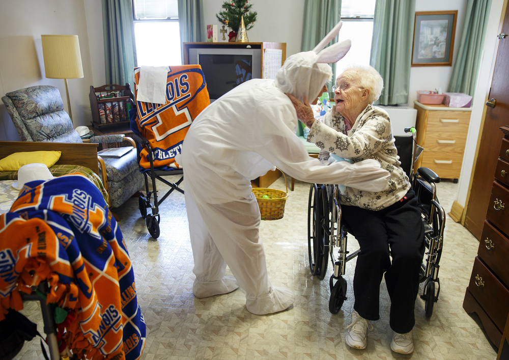 Lisa Hirstein-Hughes with Elks Lodge #158 gets a hug from Patricia Curtis after she delivered a small Easter Bunny and an egg filled with jelly beans at Saint Joseph's Home of Springfield Friday, March 25, 2016. Hirstein-Hughes has been donning the bunny outfit and making Easter deliveries for ten years. Ted Schurter/The State Journal-Register