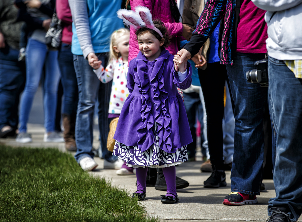 Madeline Peterson, 3, waits in line to check-in for the Eggstravaganza Easter Egg Hunt at the First United Methodist Church, Saturday, March 26, 2016, in Springfield, Ill. Justin L. Fowler/The State Journal-Register