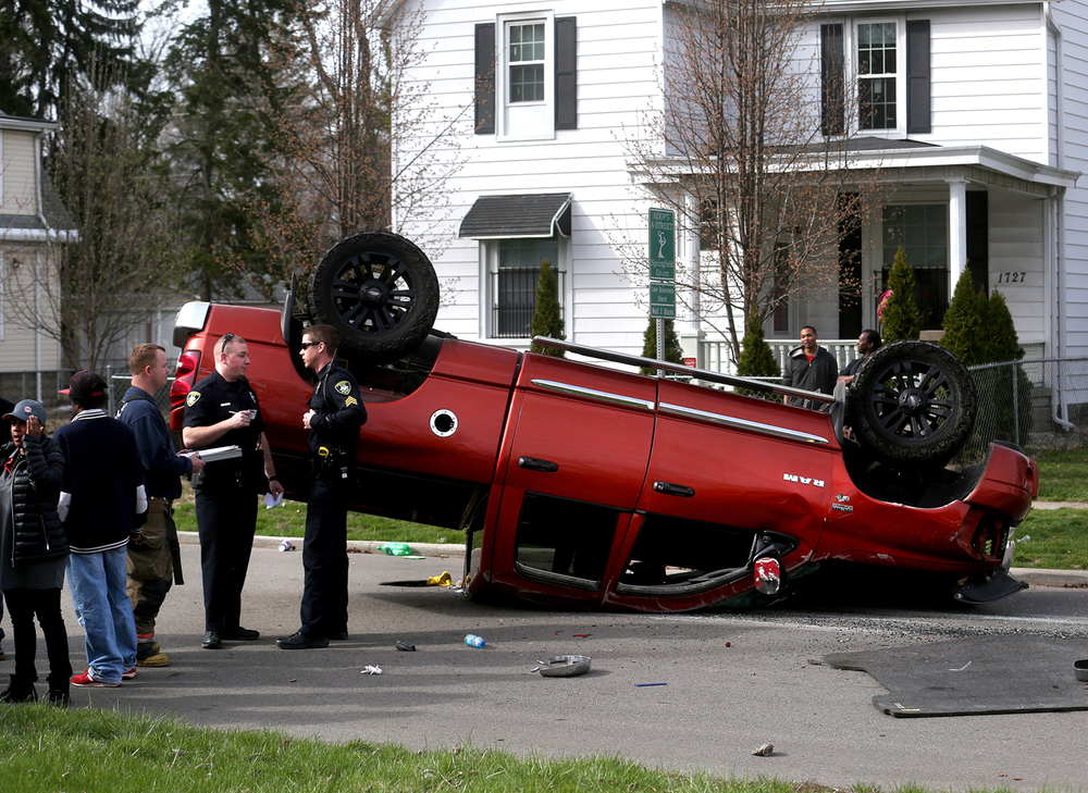 A pickup truck lies overturned in the middle of the roadway in the 1700 block of E. Jackson St. in Springfield after colliding with a small car on Tuesday afternoon, March 22, 2016. At least one occupant of the small car was transported to an area hospital. Springfield police are investigating. David Spencer/The State Journal Register
