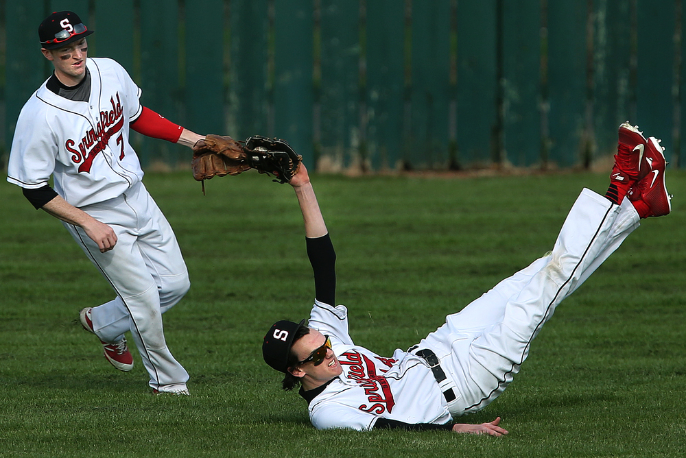 In third inning action, SHS outfielder Ethan Klay landed on his back while making an out on a pop-up hit by Glenwood. Looking on at left is Klay's teammate and outfielder Luke Ketchum. David Spencer/The State Journal Register