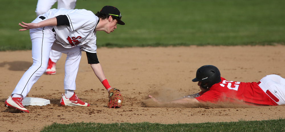 In first inning action, Glenwood baserunner Brendan Hostettler was called safe at second in front of SHS second baseman Trevor Minder, although from this angle, the call might appear dubious. David Spencer/The State Journal Register