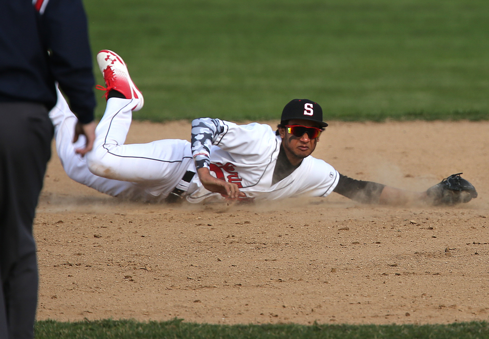In third inning action, SHS second baseman Vishakh Patel makes a diving stop before throwing out Glenwood hitter Ben Trask. SHS first baseman Damian Pierce stops the ball. David Spencer/The State Journal Register