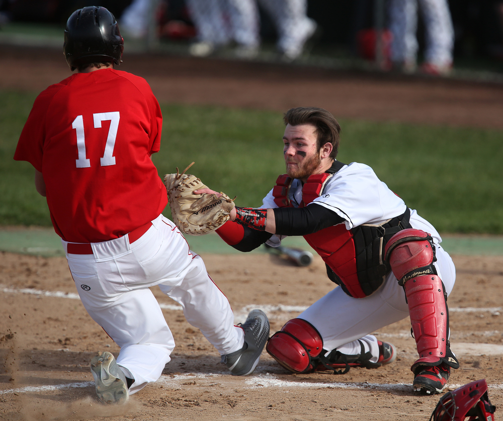 In second inning action, SHS catcher Michael Lavin prepares to tag Glenwood baserunner Ben Hartel out at home plate. David Spencer/The State Journal Register