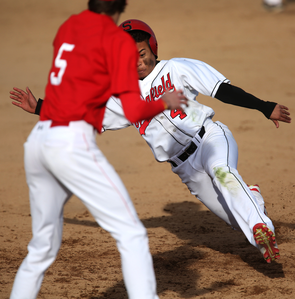 In fourth inning action, SHS baserunner Deangelo Good tried to get to third base but was called out after a tag by Glenwood's Ryan McAvoy. David Spencer/The State Journal Register