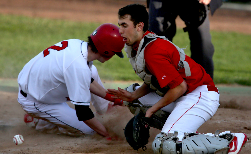 In fifth inning action, SHS baserunner Trevor Minder was safe at home in front of throw being stopped by Glenwood catcher Ben Trask. Minder represented the Senators third and final run of the game. David Spencer/The State Journal Register