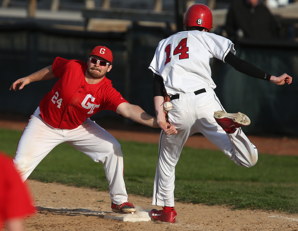In sixth inning action, SHS baserunner Ethan Klay was safe at first as Glenwood first baseman Andrew Banaitis can't snag the ball which after being thrown hit the back of Klay's arm. David Spencer/The State Journal Register
