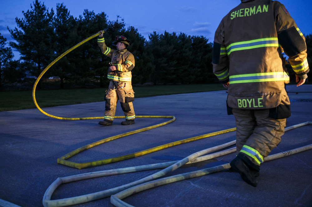 Firefighters from Williamsville and Sherman prepare to charge their hoses for an exercise designed to teach firefighters how to handle liquid propane fires presented by the Illinois Fire Service Institute at the Sherman fire station, Thursday, March 31, 2016, in Sherman, Ill. The attack on the fire featured two lines manned by firefighters and a third line at the ready if needed. Justin L. Fowler/The State Journal-Register