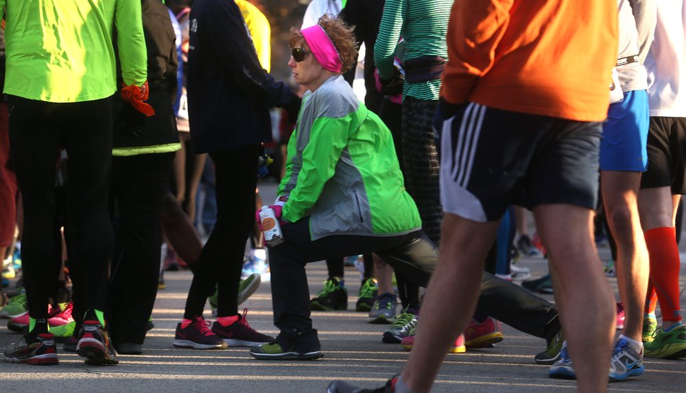 A runner stretches downtown before the start of the race Saturday morning. David Spencer/The State Journal Register