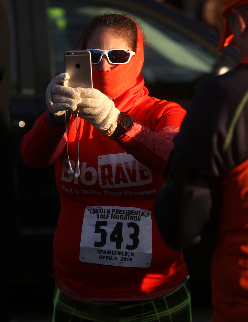 Runner Christine Guenther of Mayfield Village, OH immortalizes herself for posterity before the start of the race early Saturday morning. David Spencer/The State Journal Register