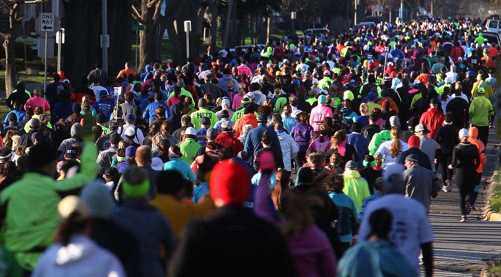 A mass of running humanity makes its way south on Eighth St. early Saturday morning. David Spencer/The State Journal Register