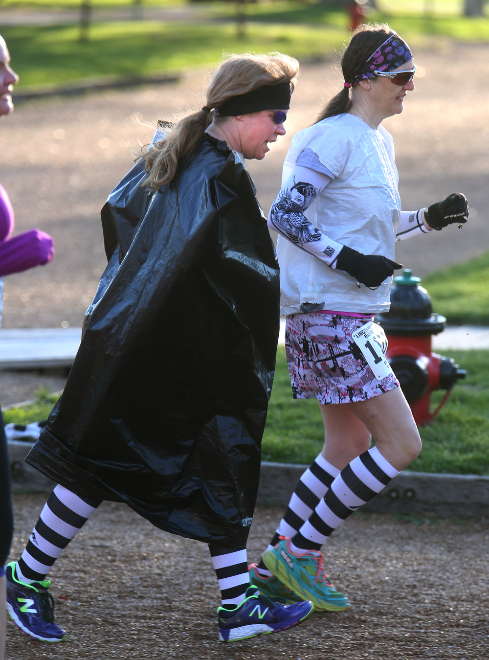 An oversized plastic garbage bag complimented this runner's striped socks as she made her way through the Lincoln Home neighborhood early Saturday morning. David Spencer/The State Journal Register