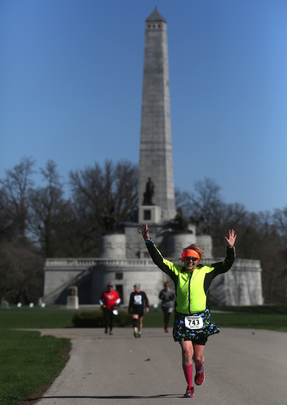 With the Lincoln Tomb in Oakridge Cemetery as a backdrop, runner Diane Kellenburger of Portage, IN makes her way towards the finish line Saturday. David Spencer/The State Journal Register
