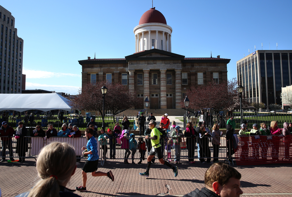 Runners prepare to cross the finish line in downtown Springfield Saturday, with the Old State Capitol as a backdrop. David Spencer/The State Journal Register