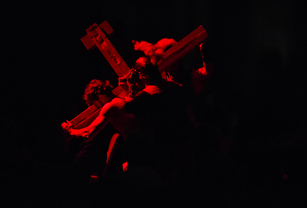 "David Hull, as Jesus, walks down the isle carry a cross and berated by Roman Soldiers in a scene during an Easter performance of ""The Thief All Access"" at the Mason City Christian Church, Sunday, March 27, 2016, in Mason City, Ill. Justin L. Fowler/The State Journal-Register"