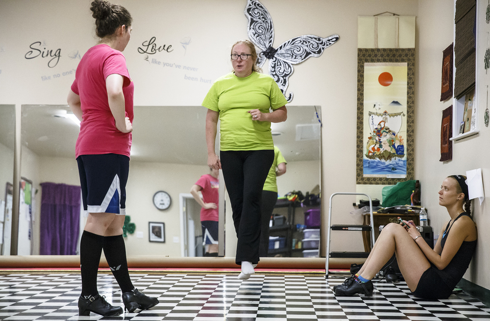Irish dance instructor Sharon Stidham, center, of the Achill Academy of Irish Dance, demonstrates a dance move to Megan Harris, left, and Michelle Holdham, right, during a session at the Academy, Monday, March 21, 2016, in Springfield, Ill. Holdham and Harris have been traveling from Peoria, Ill., to train with Stidham in their preparations for the European and World Championships in Brighton, England. Justin L. Fowler/The State Journal-Register