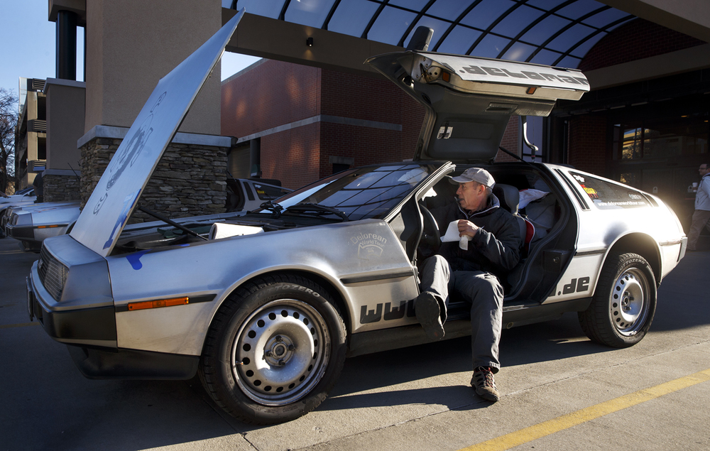 Klaus Steiner wipes the windshield of his Delorean as the Delorean World Tour caravan prepares to depart from the President Abraham Lincoln Springfield – A DoubleTree by Hilton Hotel Friday, April 1, 2016. The three European Delorean owners have been touring the world in their cars, starting in Austria in May 2015 and traveling through Nepal, India, Thailand, Australia and other countries on their way to the United States. The tour will end in Belfast, Ireland in time for the 35th birthday of the Delorean. The Springfield stop was part of a promotion for the DeLorean Convention and Show 2016, scheduled in Springfield in late July. Ted Schurter/The State Journal-Register