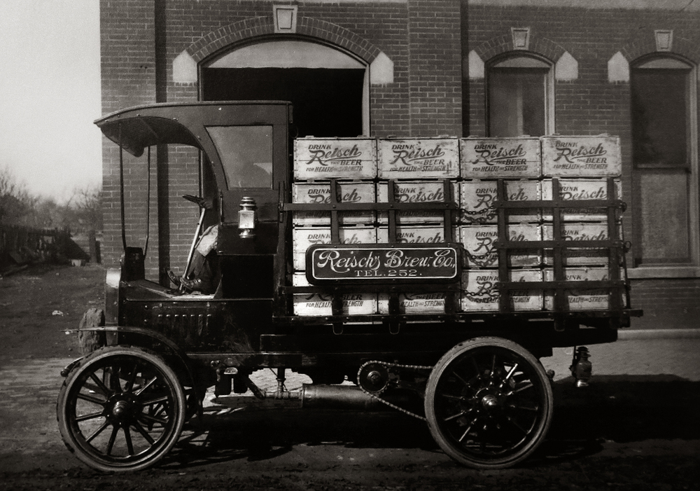 "Parked on Rutledge street in front of the brewery and loaded with wooden crates of Reisch beer stamped with the saying: ""Drink Reisch-The Beer For Health and Strength"", this chain driven Marquette, said to be from 1906, was the first motor delivery truck purchased by the Reisch Brewery. The Reisch Brewing website states ""It was a novelty to see this truck rumble along its way with a load of beer. Soon other trucks were added. One was called the Mais, then an Oneida, and later Federals and Fords."" Photograph courtesy Sangamon Valley Collection at Lincoln Library"