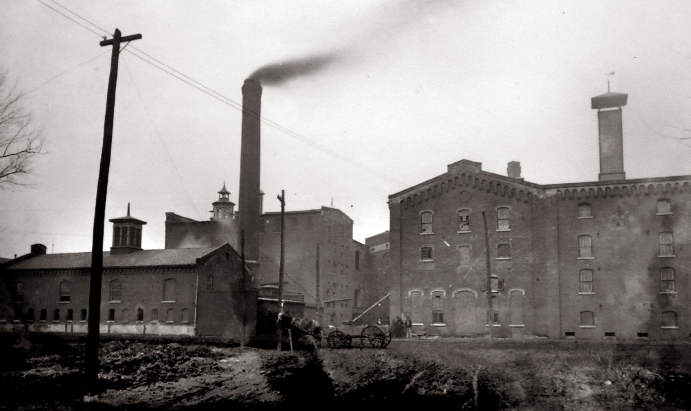 A ca. 1900 or before photograph shows smoke belching from one of the smokestacks at the Reisch Brewery on North Rutledge Street. Photograph courtesy Sangamon Valley Collection at Lincoln Library
