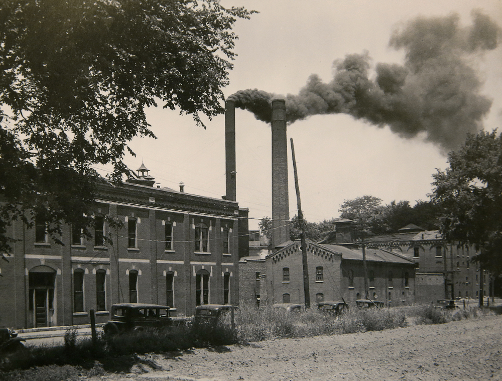 "A 1968 newspaper clipping in the State Journal-Register stated of this 1934 view of the Reisch Brewery, with a smokestack belching smoke after the conclusion of Prohibition: ""just about two years earlier the company was making plans to return to production of beer after a prohibition of making only malt and soda water."" The street at bottom with a line of cars is North Rutledge St. Photograph courtesy Sangamon Valley Collection at Lincoln Library"