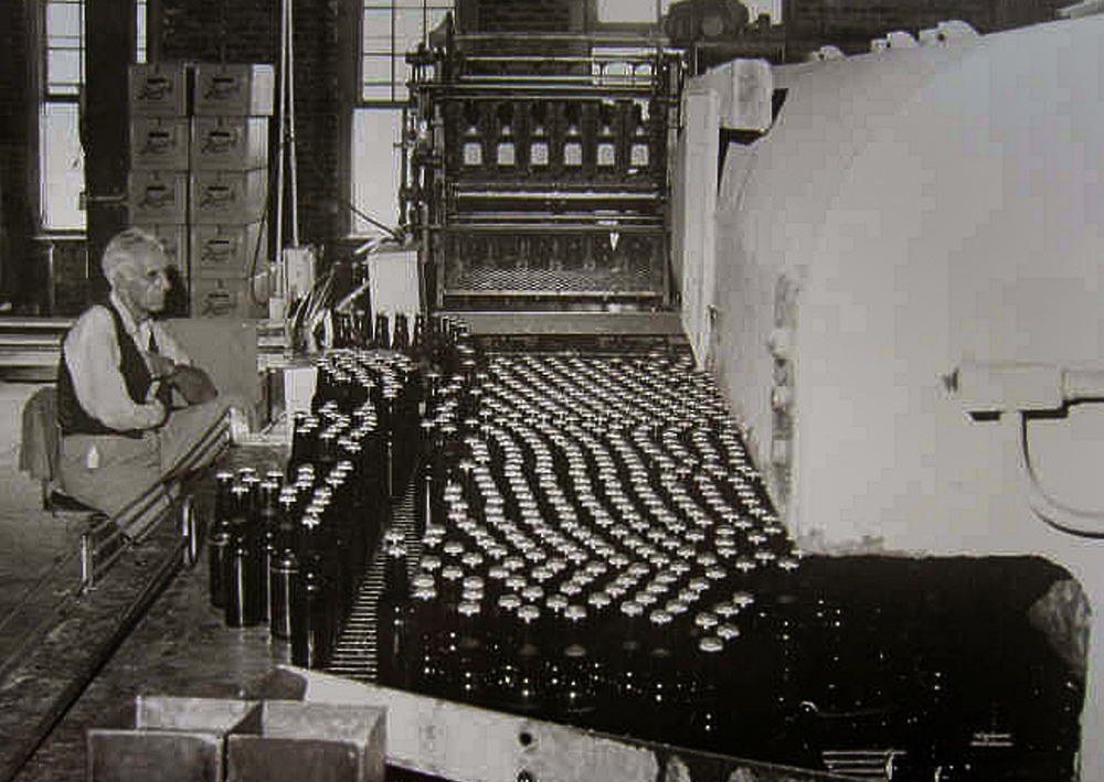 Illinois State Journal staff photographer Dick Binetsch took this photograph of 15-year Reisch Brewing Company employee Bob Peters doing a final inspection on some of the last glass bottles of Reisch beer coming off the line on the final day of operation at the brewery on July 28, 1966. Photograph courtesy Sangamon Valley Collection at Lincoln Library