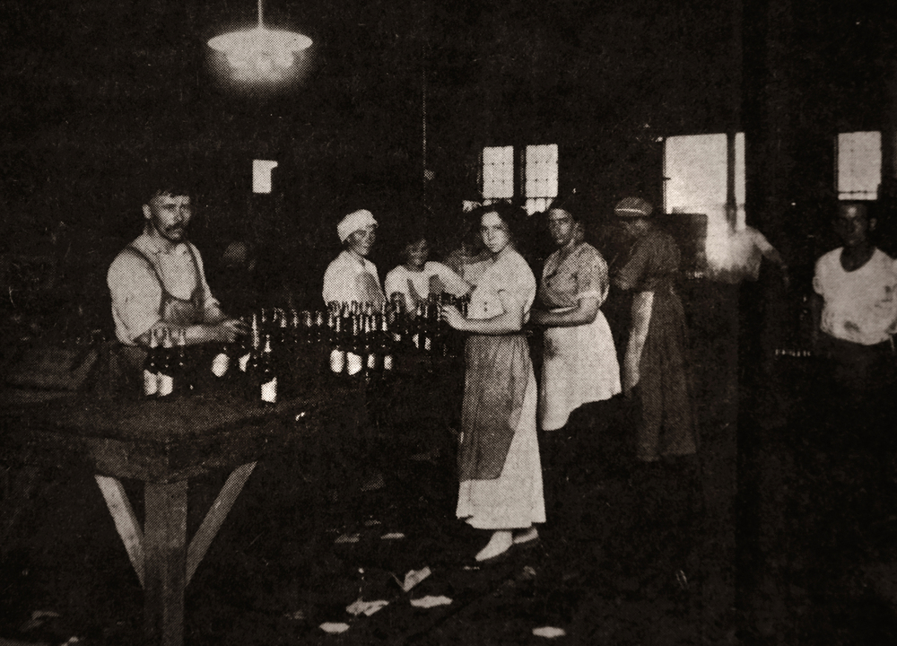 A newspaper clipping taken from the State Journal-Register from June 26, 1981 shows employees of the Reisch Brewing Company on North Rutledge Street hand-pasting labels onto beer bottles in 1913. At left is Reisch employee Carl Runkel Sr. Photo is courtesy Catherine Radford, R.R. 9, Springfield. Photograph courtesy Sangamon Valley Collection at Lincoln Library