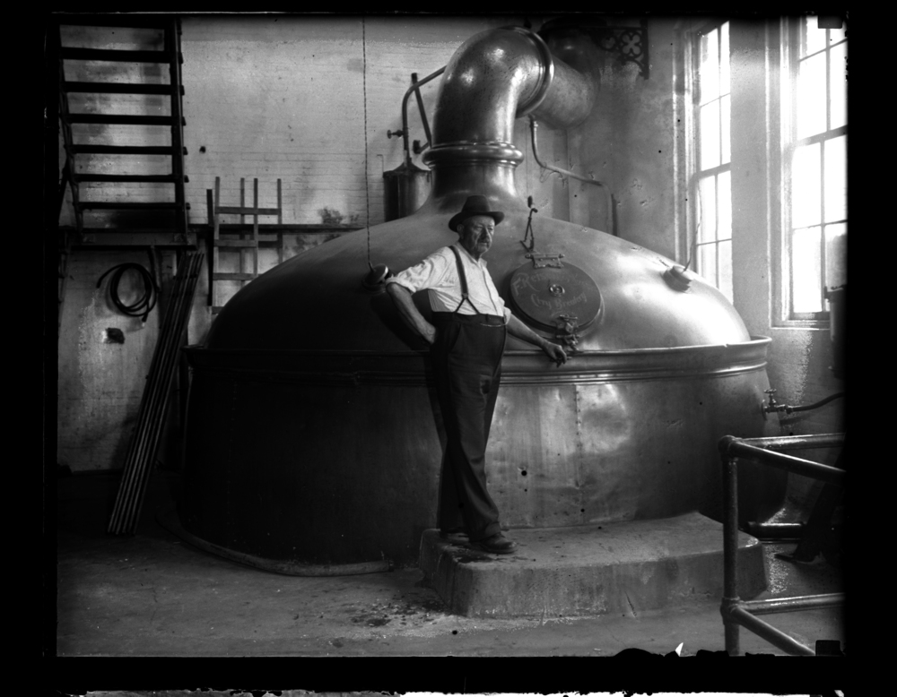Conrad Griesser, brewmaster for F. Reisch and Sons, stands in front of a brew kettle with a 360-barrel capacity just days before the brewery reopened after Prohibition, July 8, 1934. Photograph courtesy Sangamon Valley Collection at Lincoln Library