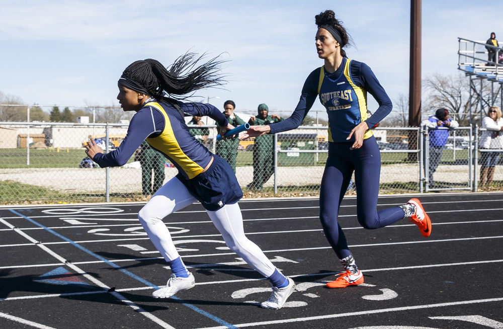 Southeast's Dontavia Howard takes the baton from Lunden Henry, right, to run her leg in the 4x400m Relay during the Thomas McBride Invitational track and field meet at Southeast High School , Saturday, April 9, 2016, in Springfield, Ill. Justin L. Fowler/The State Journal-Register