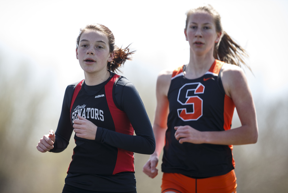 Springfield's Natalie Motor, left, battles with Shepard's Kelli Callahan in the 3200m Run during the Thomas McBride Invitational track and field meet at Southeast High School , Saturday, April 9, 2016, in Springfield, Ill. Motor finished second with a time of 11:47.61. Justin L. Fowler/The State Journal-Register