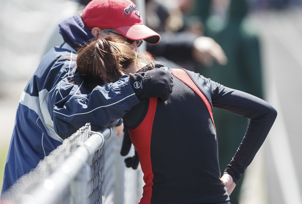 Springfield's Natalie Motor gets a hug from her father, Mike Motor, after finishing second in the 3200m Run during the Thomas McBride Invitational track and field meet at Southeast High School , Saturday, April 9, 2016, in Springfield, Ill. Justin L. Fowler/The State Journal-Register
