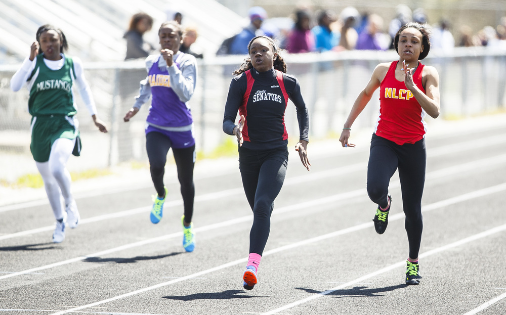 Springfield's Ozzy Erewele sets a new school record with a 12.06 defeating Chicago North Lawndale Charter's Gabrielle Desrosiers, right, in the 100m Dash during the Thomas McBride Invitational track and field meet at Southeast High School , Saturday, April 9, 2016, in Springfield, Ill. Justin L. Fowler/The State Journal-Register