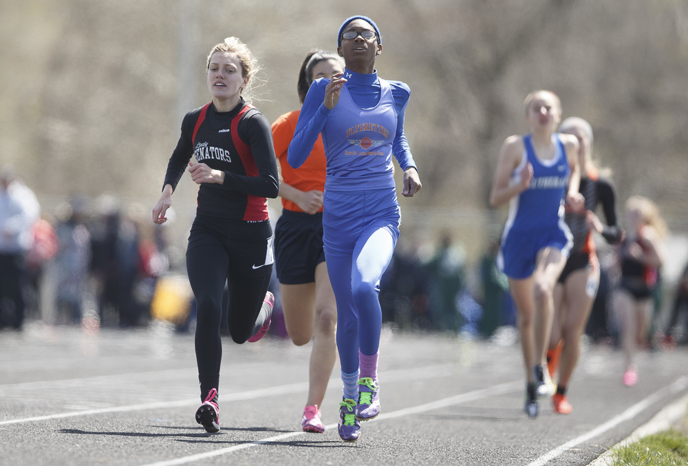 Springfield's Aly Goff runs against East St. Louis' Shonjahnah Griggs on the first lap of the 800m Run during the Thomas McBride Invitational track and field meet at Southeast High School , Saturday, April 9, 2016, in Springfield, Ill. Goff finished second with a time of 2:22.72. Justin L. Fowler/The State Journal-Register