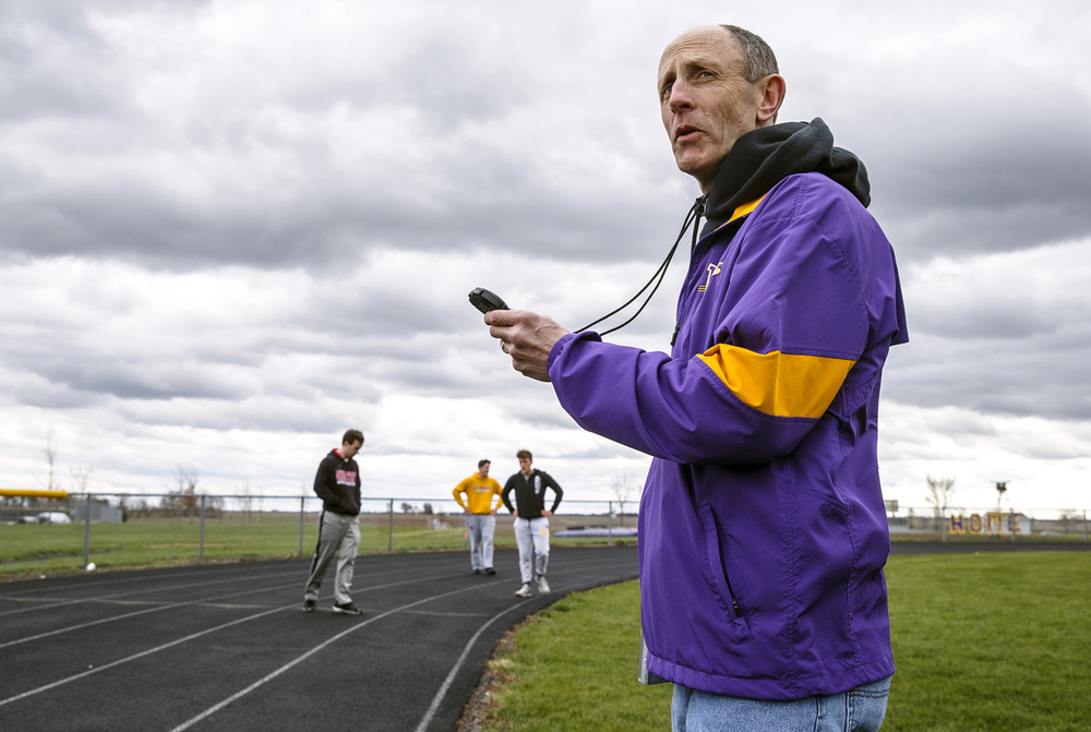 Williamsville boys track coach Don Williams keeps the time for his throwers as they go through conditioning during practice at Paul Jenkins Field, Wednesday, April 6, 2016, in Williamsville, Ill. Williams will be retiring after his 23rd year at the helm of the school's program. Justin L. Fowler/The State Journal-Register