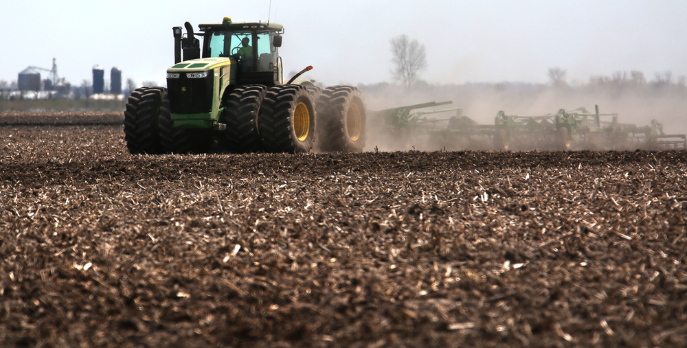 A farm tractor tills a field in preparation for spring planting south of Standard City Rd. in Macoupin County on Tuesday, April 5, 2016. David Spencer/The State Journal-Register