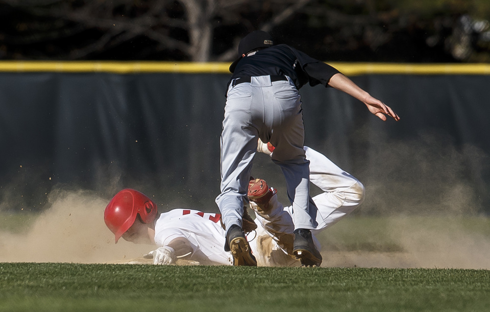 Glenwood's Ryan McAvoy slides safely into second base against Sacred Heart-Griffin's Brian Zanger in the second inning at Chatham Community Park, Thursday, April 14, 2016, in Chatham, Ill. Justin L. Fowler/The State Journal-Register