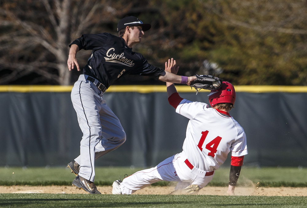 Glenwood's Todd Fowler beats the tag from Sacred Heart-Griffin's Patrick Belz for a stolen base in the third inning at Chatham Community Park, Thursday, April 14, 2016, in Chatham, Ill. Justin L. Fowler/The State Journal-Register