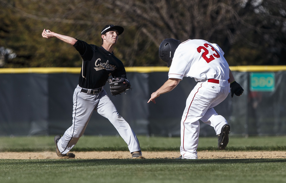 Sacred Heart-Griffin's Patrick Belz turns a double play after getting Glenwood's Brendan Hostettler out a second to get the Cyclones out of the fourth inning at Chatham Community Park, Thursday, April 14, 2016, in Chatham, Ill. Justin L. Fowler/The State Journal-Register