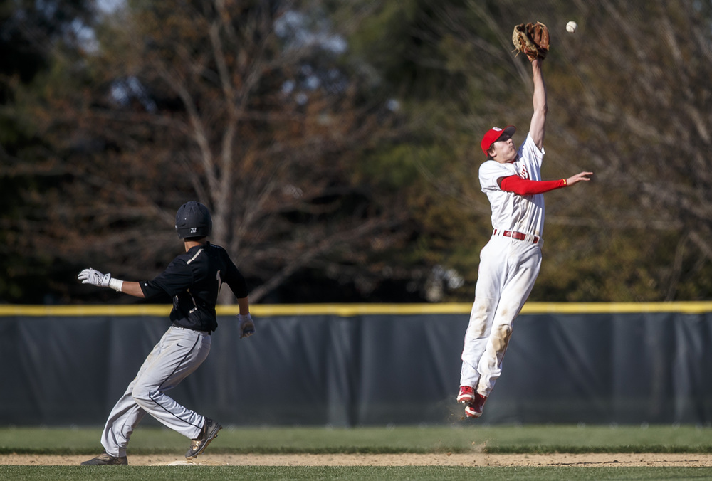 Glenwood's Ryan McAvoy leaps up to catch a throw from first to hold Sacred Heart-Griffin's Brian Zanger at second base after he advanced on a errant throw in the fifth inning at Chatham Community Park, Thursday, April 14, 2016, in Chatham, Ill. Justin L. Fowler/The State Journal-Register