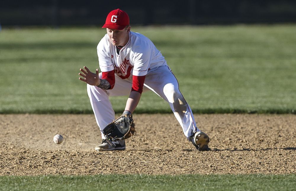Glenwood's Graham Bender fields a ground ball for an out against Sacred Heart-Griffin in the seventh inning at Chatham Community Park, Thursday, April 14, 2016, in Chatham, Ill. Justin L. Fowler/The State Journal-Register
