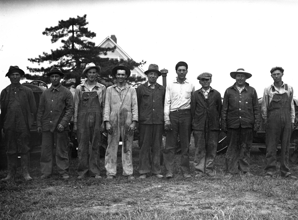 men (farmers?) in front of tractors. Illinois State Journal/Register glass plate negative/Sangamon Valley Collection at Lincoln Library  C-98-691, neg# 986 VF 2000-64  Pub. ISJ April 21, 1931